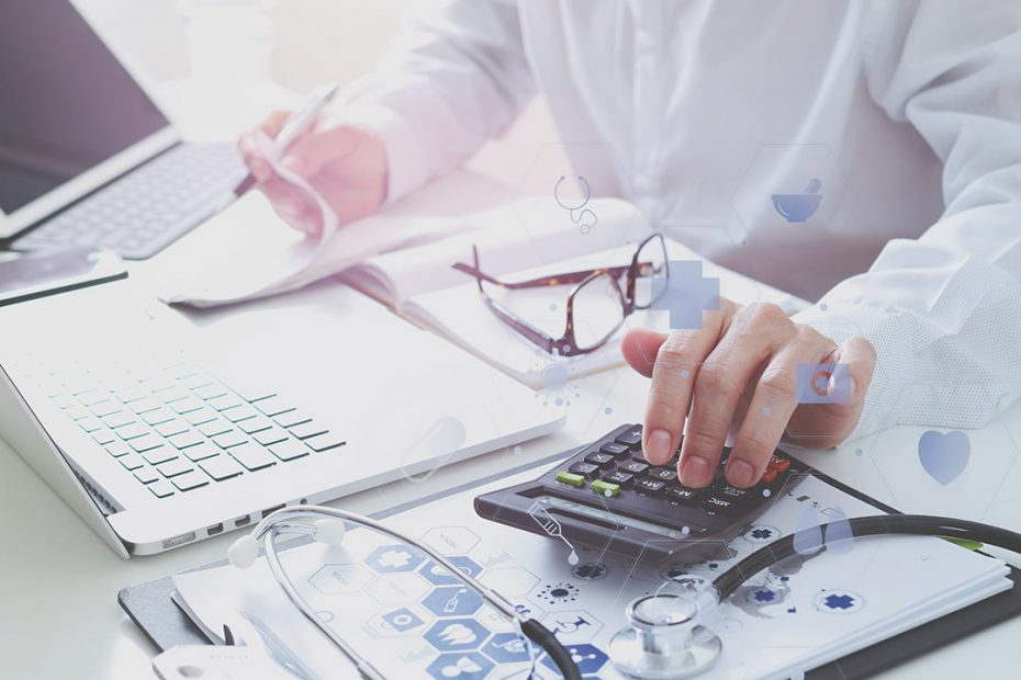 Hand of a person using a calculator and doing paperwork regarding medical billing