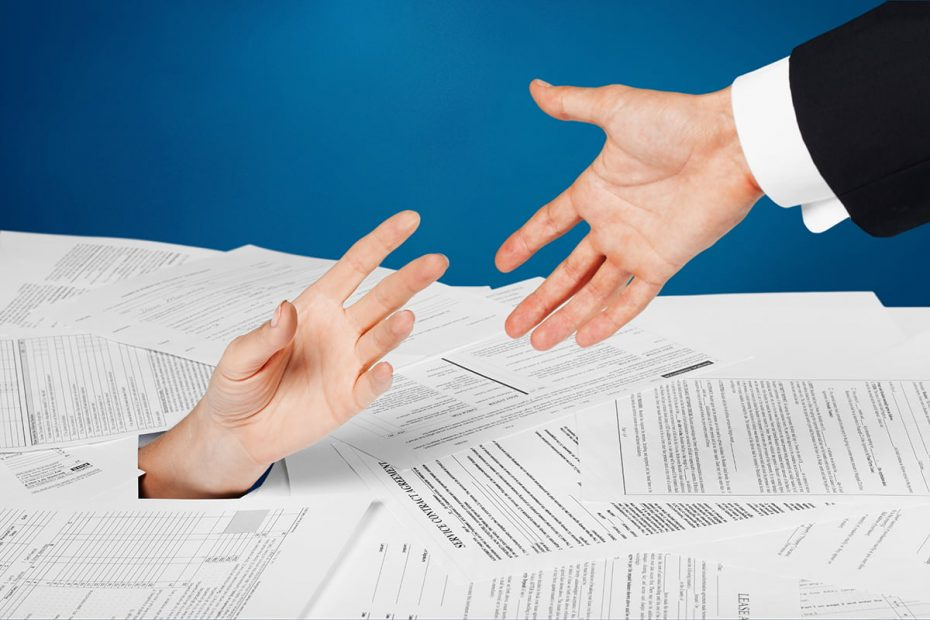 Close up of businesswoman hand in stack