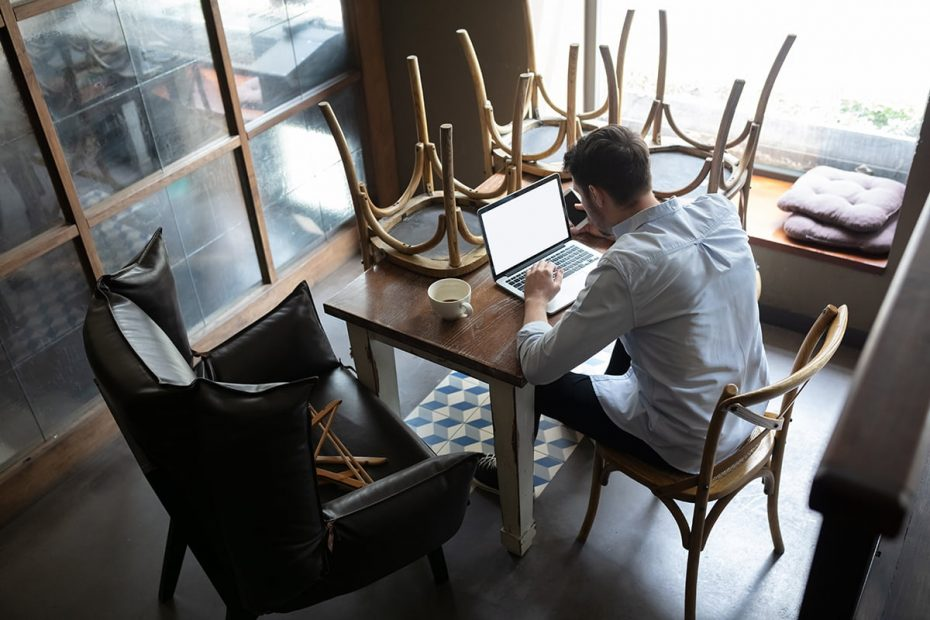 Restaurant, cafe, bar closed due to COVID-19 or Coronavirus outbreak lockdown, stressed owner of small business trying to find solution, top view